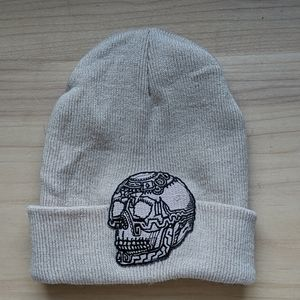 Tan beanie hat with skull embroidery